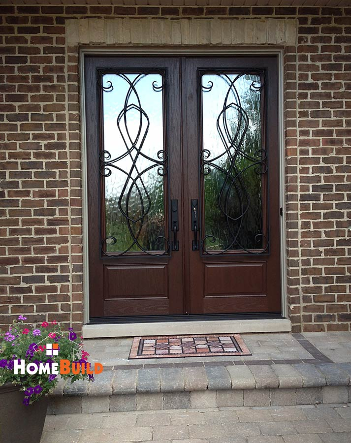 Pella french entry door with custom wrought iron trim on the pella architect series fiberglass french door with wrought iron exterior trim and dark mahogany stain planetlyrics Choice Image